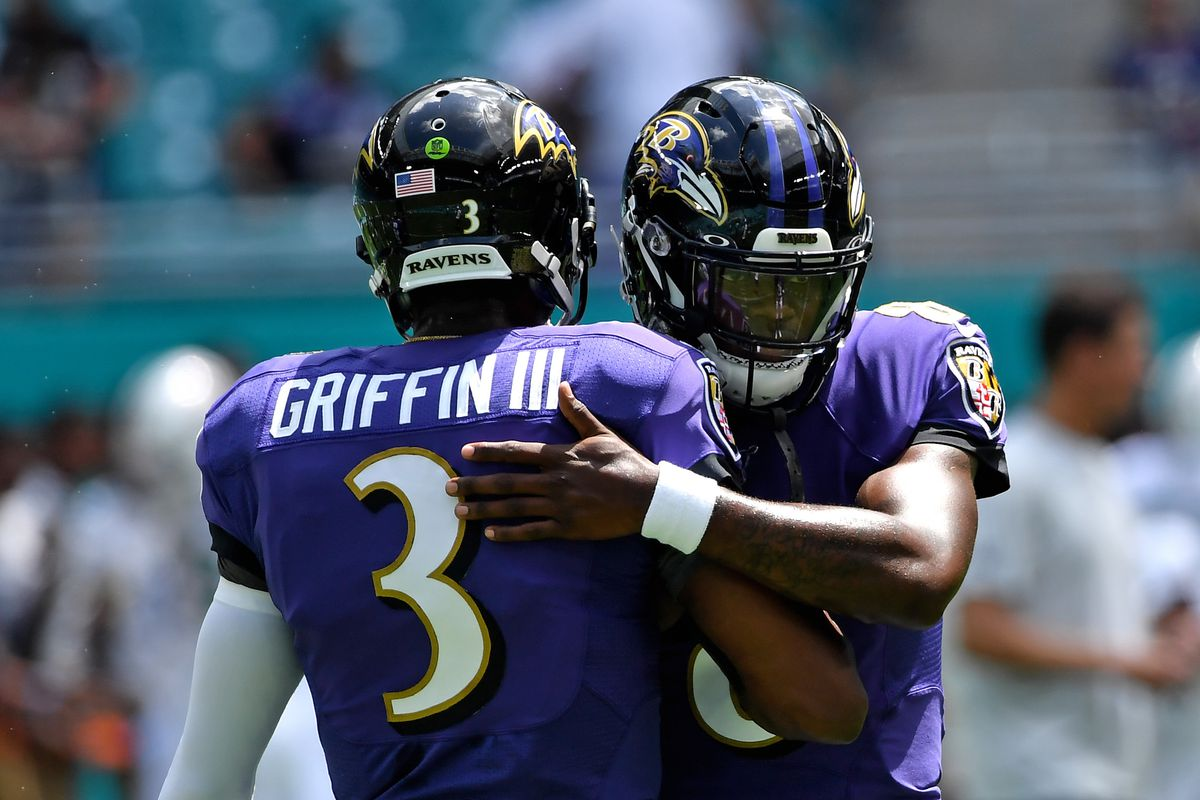 Baltimore Ravens quarterback Lamar Jackson greets quarterback Robert Griffin III before a game against the Miami Dolphins at Hard Rock Stadium.
