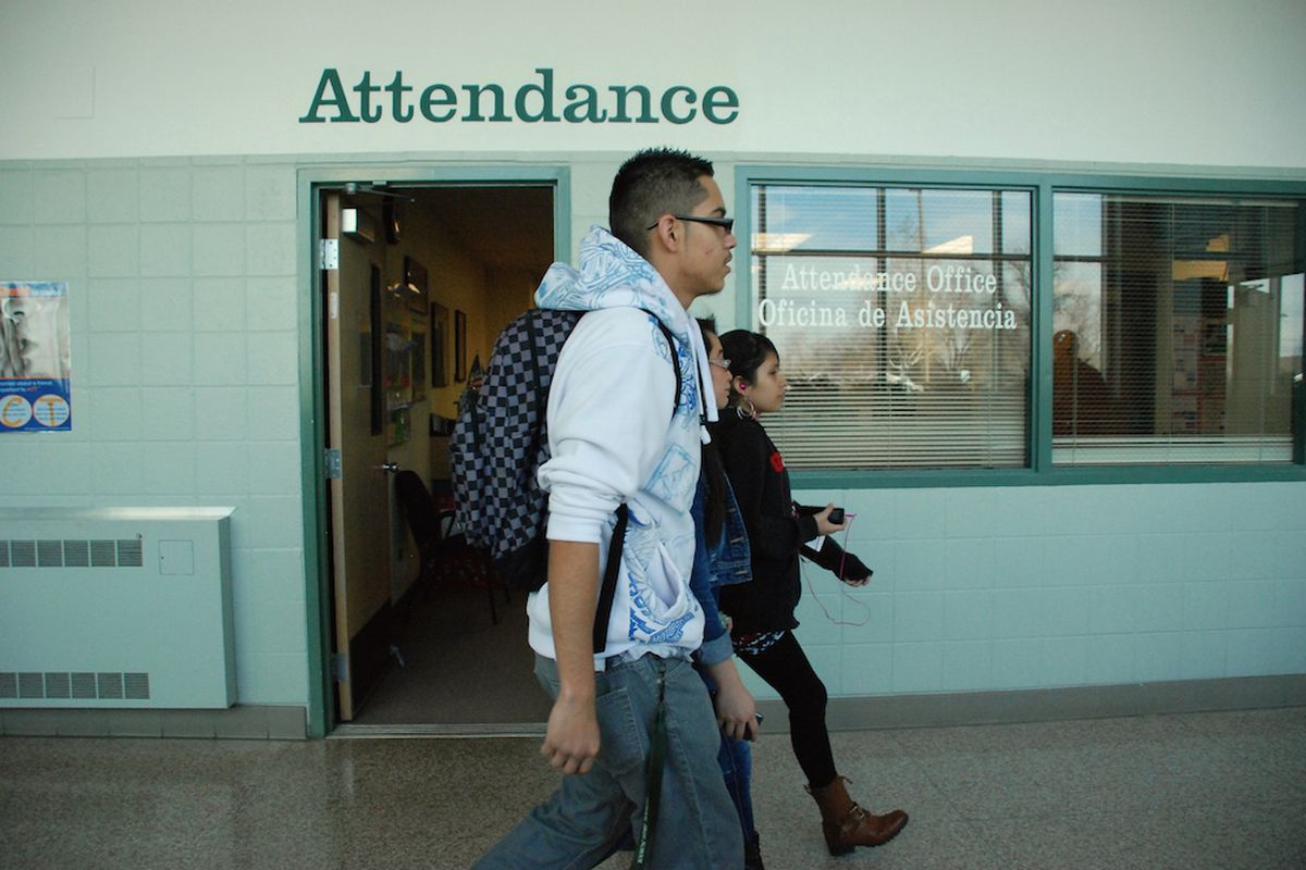 Aurora Central High School students walk past the attendance office.