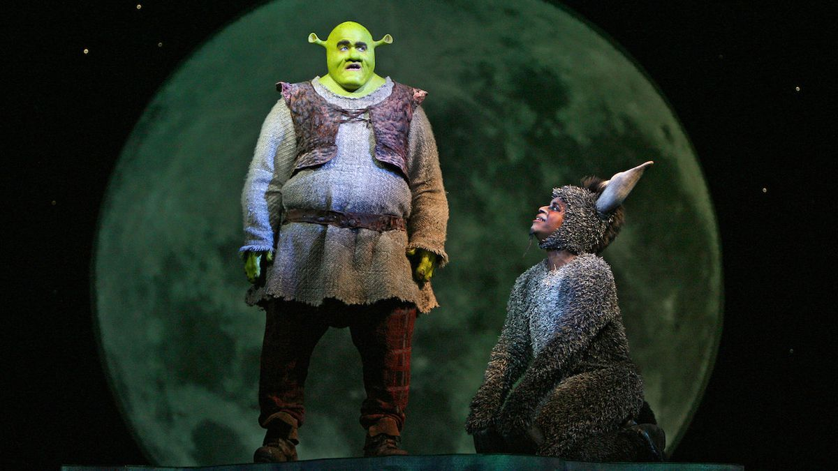 Shrek (Brian d'Arcy James) and Donkey (Daniel Breaker) stand in front of the moon