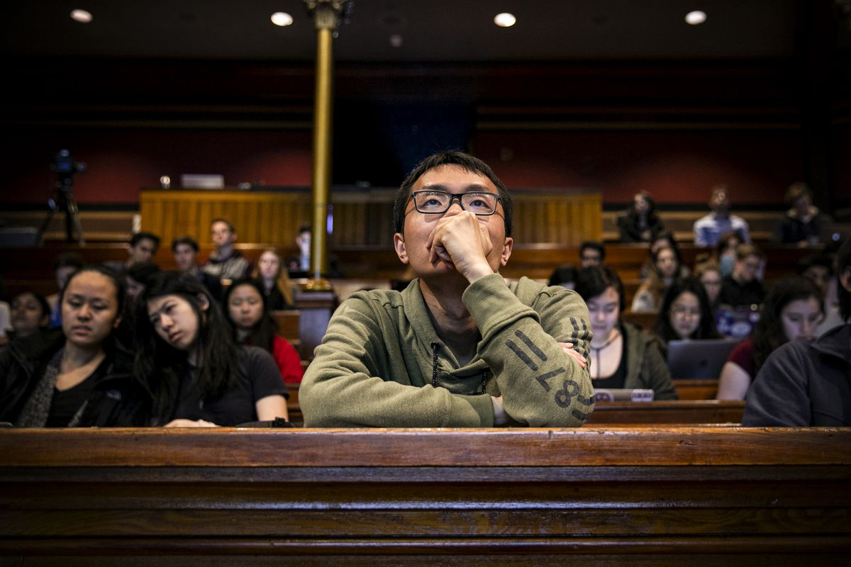 Students watching Raj Chetty's lecture in Economics 1152 on April 23, 2019.