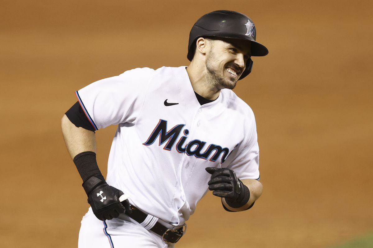 Adam Duvall #14 of the Miami Marlins rounds the bases after hitting a two-run home run against the Colorado Rockies during the seventh inning at loanDepot park