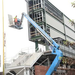 4:15 p.m. More panels going up on the back of the right-field video board -