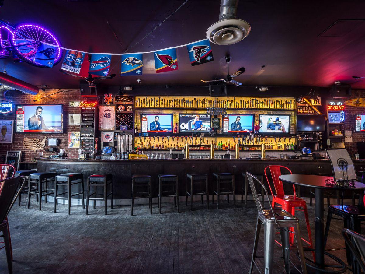 A bar with TVs