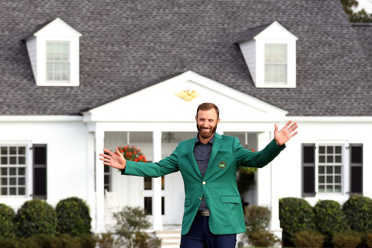 Dustin Johnson of the United States reacts during the Green Jacket Ceremony after winning the Masters at Augusta National Golf Club on November 15, 2020 in Augusta, Georgia.