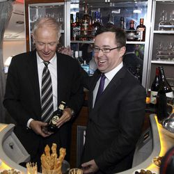 Qantas CEO Alan Joyce, right, and Emirates President Tim Clark pose for photos in the bar of business class A-380 Emirates aircraft after announcing a global aviation partnership in Sydney, Australia, Thursday, Sept. 6, 2012. Qantas Airways Ltd. announced Thursday that it has signed a 10-year partnership deal with rival Emirates in a bid to boost the Australian airline's struggling international division. The deal is subject to regulatory approval.
