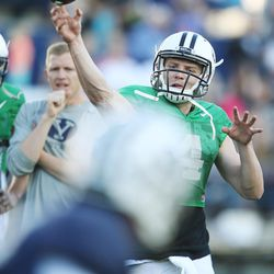 BYU quarterback Taysom Hill throws during the Cougars' spring football game in Provo  Friday, March 27, 2015.