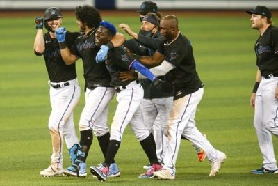 Miami Marlins second baseman Jazz Chisholm Jr. (2) celebrates with catcher Jorge Alfaro (38) and shortstop Miguel Rojas (19) and left fielder Corey Dickerson (23) and center fielder Starling Marte (6) after winning the game against the San Francisco Giants at loanDepot park.