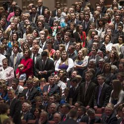 Members of the audience stand prior to the start of the morning session of 183 annual General Conference of the Church of Jesus Christ of Latter Day Saints Saturday, April 6, 2013 inside the Conference Center.