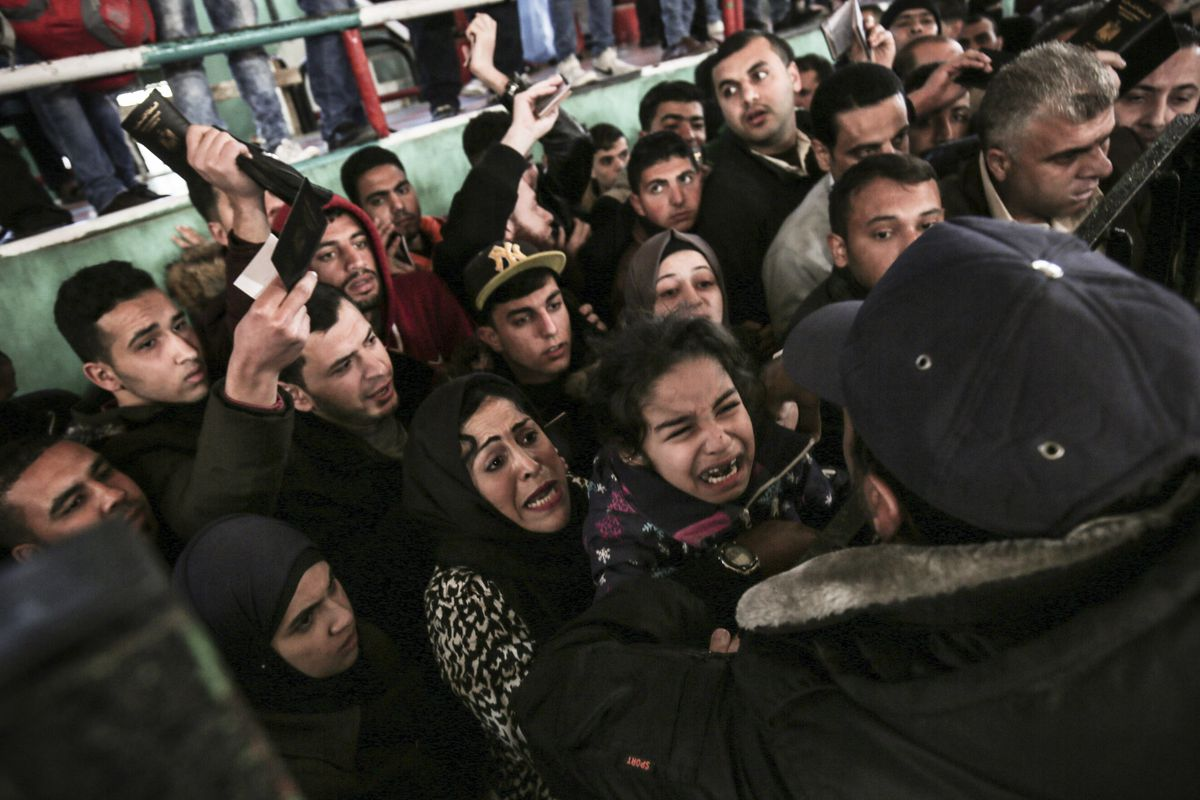Palestinians wait for permission to cross into Egypt through the Rafah border in the southern Gaza Strip after it was opened, on February 21, 2018. Egypt temporarily opened Rafah crossing point on the borders with the Gaza Strip in both directions for fou