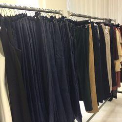 Racks of navy leather pants