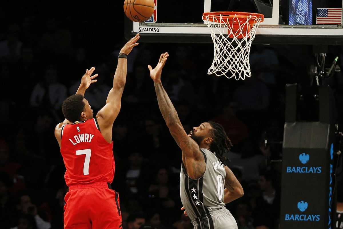 Toronto Raptors guard Kyle Lowry shoots against Brooklyn Nets center DeAndre Jordan during the second half at Barclays Center.