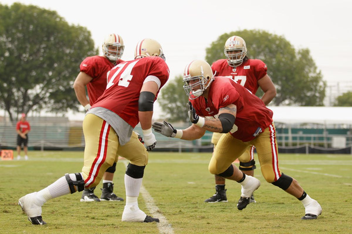 SANTA CLARA CA - AUGUST 02:  Joe Staley #74 and Alex Boone #75 work out during the San Francisco 49ers training camp at their training complex on August 2 2010 in Santa Clara California.  (Photo by Ezra Shaw/Getty Images)