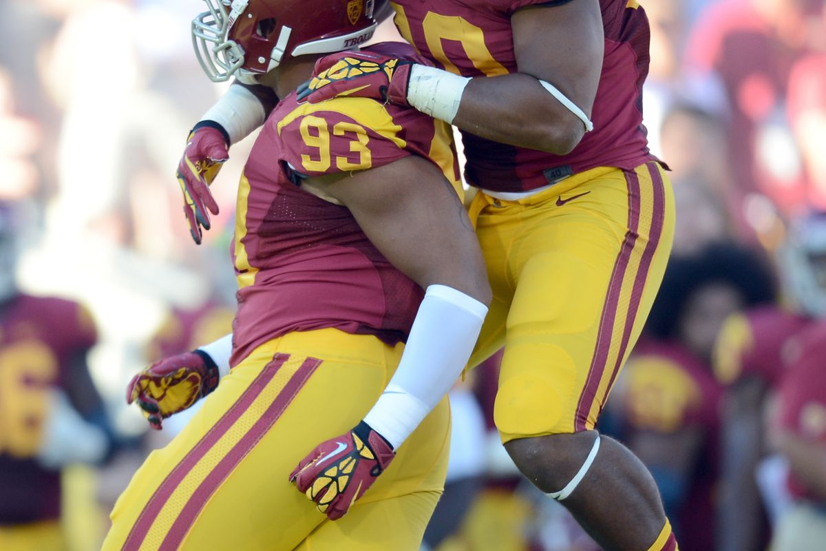 LOS ANGELES, CA - SEPTEMBER 01:  Hayes Pullard #10 of the USC Trojans celebrates the sack of Greg Townsend Jr. #93 against the Hawaii Warriors at Los Angeles Coliseum on September 1, 2012 in Los Angeles, California.  (Photo by Harry How/Getty Images)
