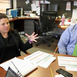 Ivy Estabrooke, executive director of the Utah Science Technology and Research Initiative, leads a meeting at the USTAR office in Salt Lake City on Tuesday, May 30, 2017.  Finance manager Lincoln Clark is to her right.