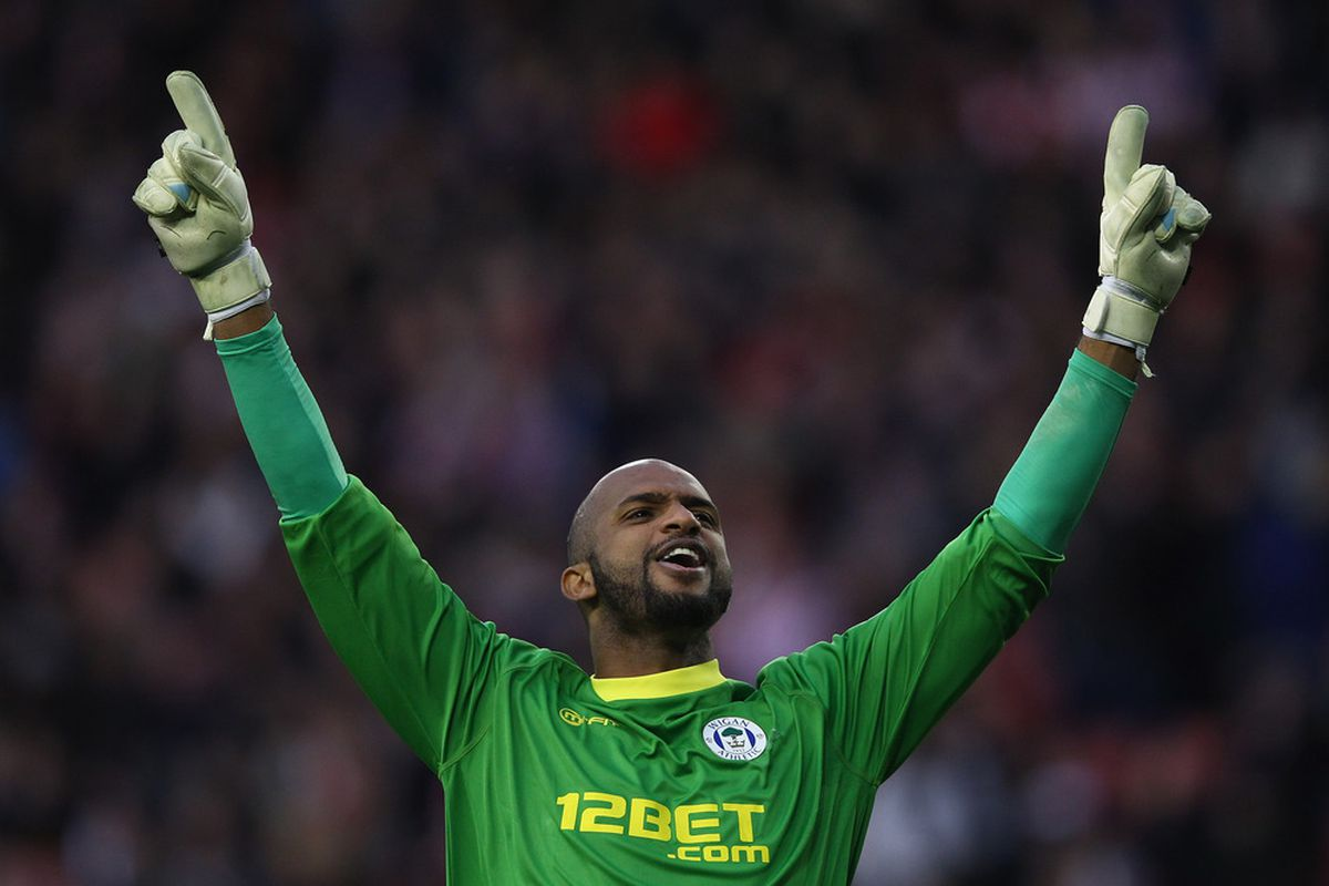 Ali Al Habsi celebrates another well earned point for Wigan Athletic
