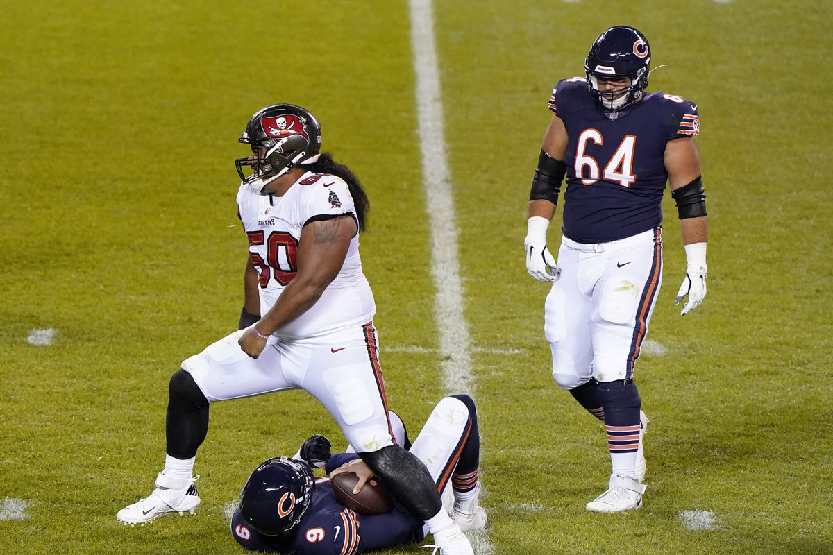 Tampa Bay Buccaneers nose tackle Vita Vea (50) sacks Chicago Bears quarterback Nick Foles (9) during the third quarter at Soldier Field.
