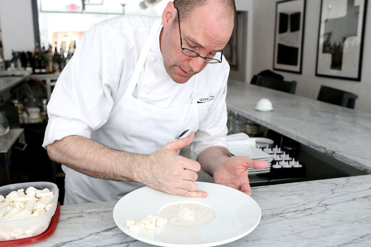 Pastry chef David Collier plates a dessert at Spoon.