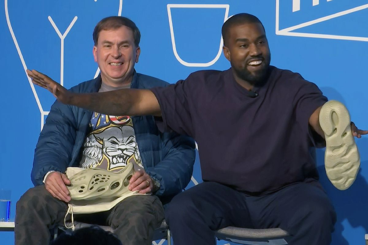 This image taken from video shows Kanye West, right, with Steven Smith, lead designer at Yeezy during a discussion on fashion and design at the Fast Company Innovation Festival in New York on Thursday.