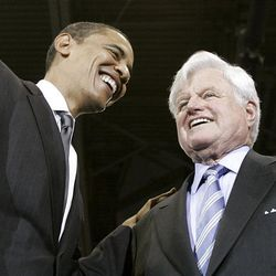 Then-Democratic presidential hopeful Sen. Barack Obama, D-Ill., smiles with Sen. Edward M. Kennedy, D-Mass., during a rally at American University in Washington on Jan. 28, 2008, where Kennedy endorsed Obama.