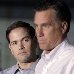 In this April 23, 2012 file photo, Sen. Marco Rubio, R-Fla., listens at left as former presidential candidate Mitt Romney speaks in Aston, Pa. Rubio is one of at least six Republican contenders for the White House who will be in Utah through Saturday to meet with a select group of Romney's top contributors at an upscale ski resort.