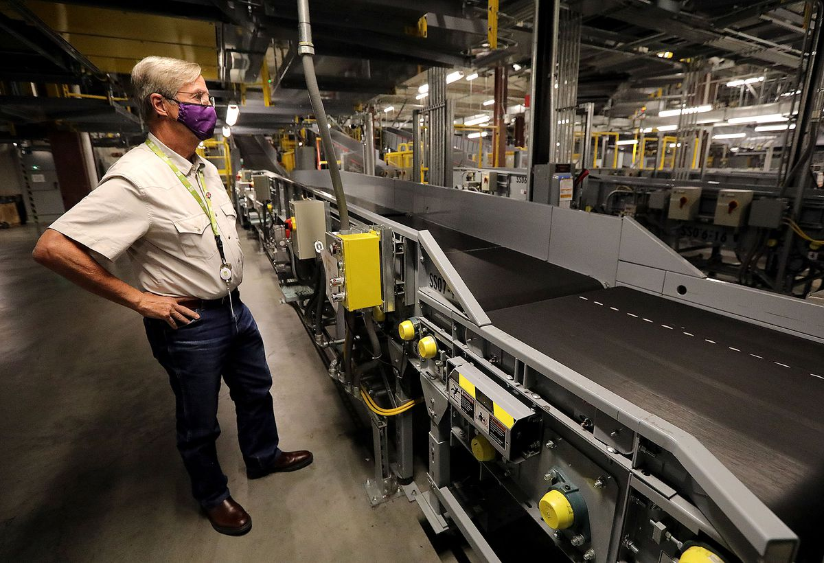 Bill Wyatt, director of the Salt Lake City International Airport , gives a tour of the room where checked luggage is scanned at the airport in Salt Lake City on Thursday, Aug. 26, 2021.