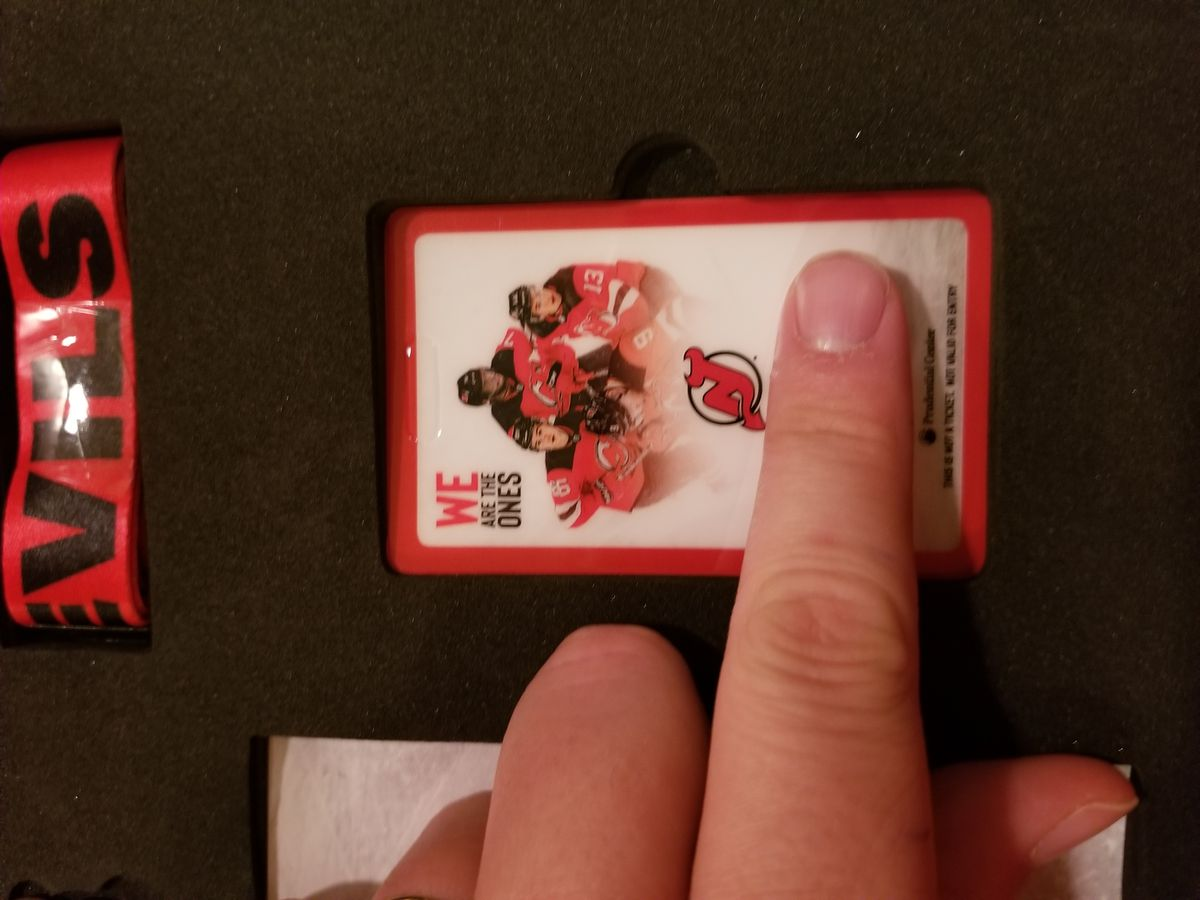 The 2019-20 Membership Card and John's left index finger