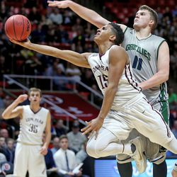 Lone Peak's Frank Jackson shoots past Copper Hills' Porter Hawkins as Lone Peak  High School and Copper Hills High School  play in the 5A State Boys Basketball State Tournament quarterfinals Thursday, March 3, 2016, in Salt Lake City.