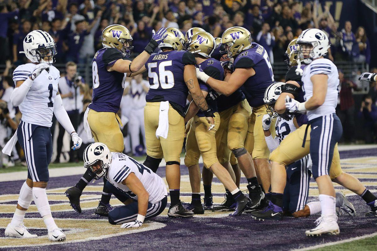 Washington Huskies quarterback Jake Browning (3) scores against the Brigham Young Cougars in Seattle on Saturday, Sept. 29, 2018.