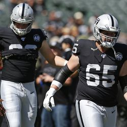 Oakland Raiders offensive guard Jordan Devey (65) and defensive end Maxx Crosby (98) during introductions before an NFL football game against the Kansas City Chiefs Sunday, Sept. 15, 2019, in Oakland, Calif.