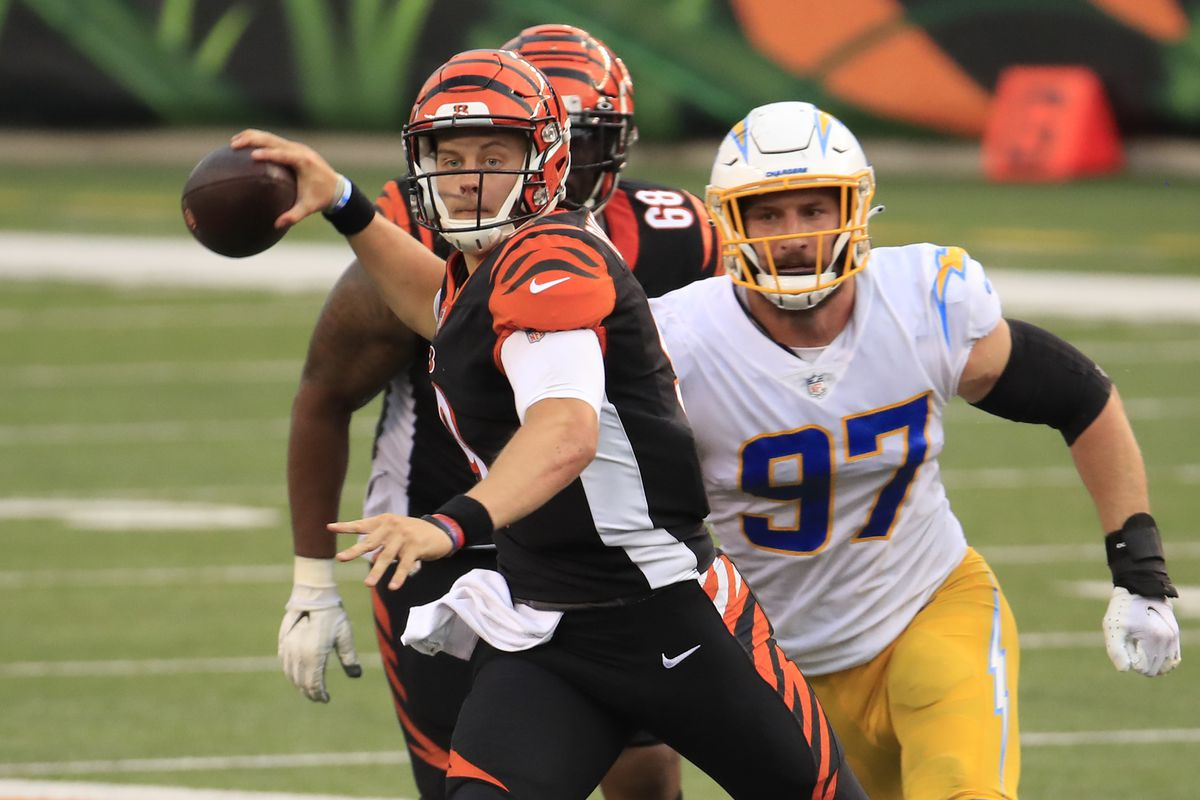 Quarterback Joe Burrow of the Cincinnati Bengals looks to pass against the Los Angeles Chargers during the second half at Paul Brown Stadium on September 13, 2020 in Cincinnati, Ohio.