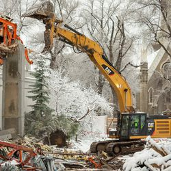 Photos provided Friday, Jan. 17, 2020, show crews working on the reconstruction of Temple Square.
