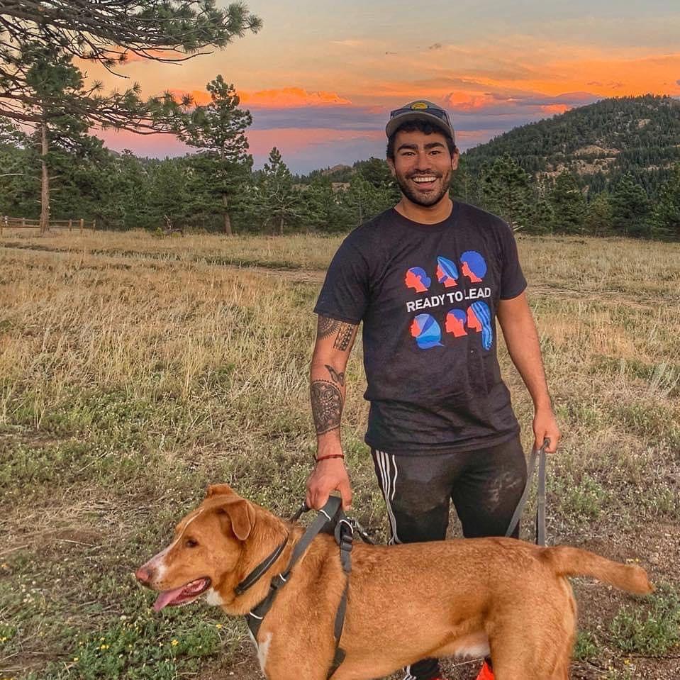 A photograph of Felipe Vieyra and his dog.