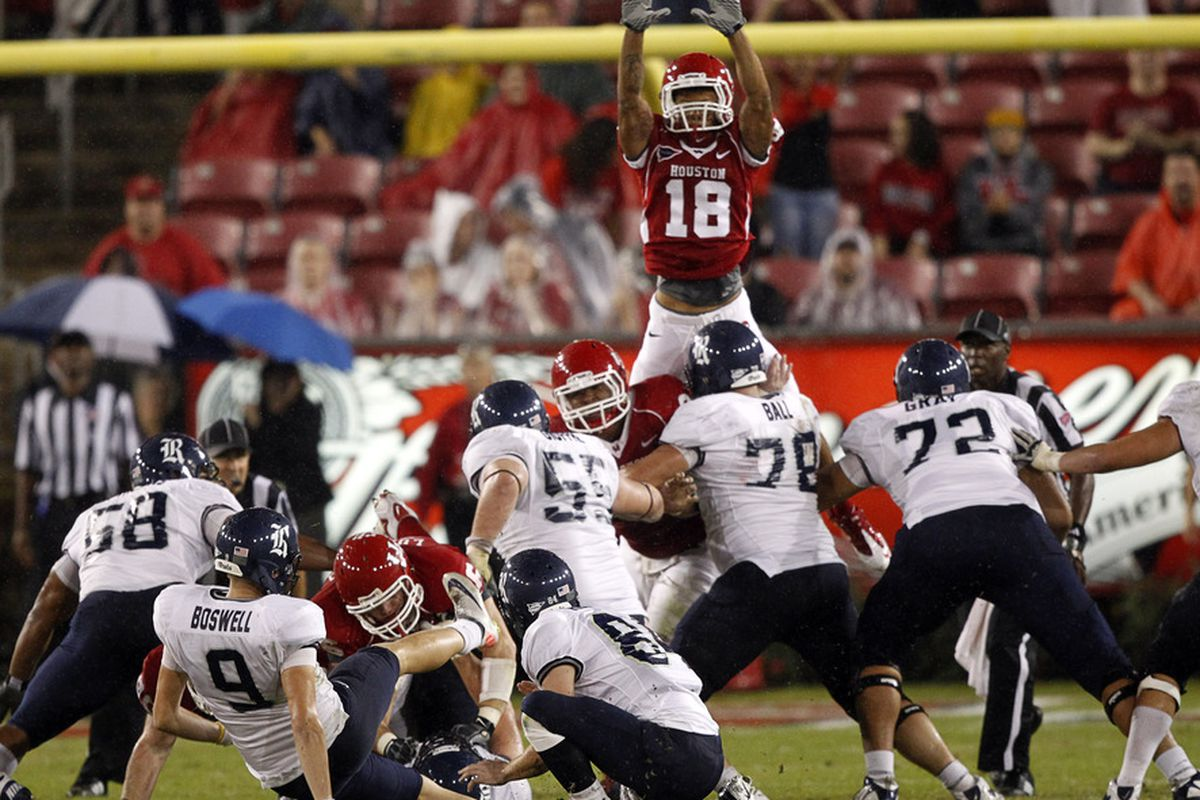 HOUSTON - OCTOBER 27:  Kicker Chris Boswell #9 of the Rice Owls loses his footing as he misses this field goal attempt against the Houston Cougars at Robertson Stadium on October 27, 2011 in Houston, Texas.  (Photo by Bob Levey/Getty Images)