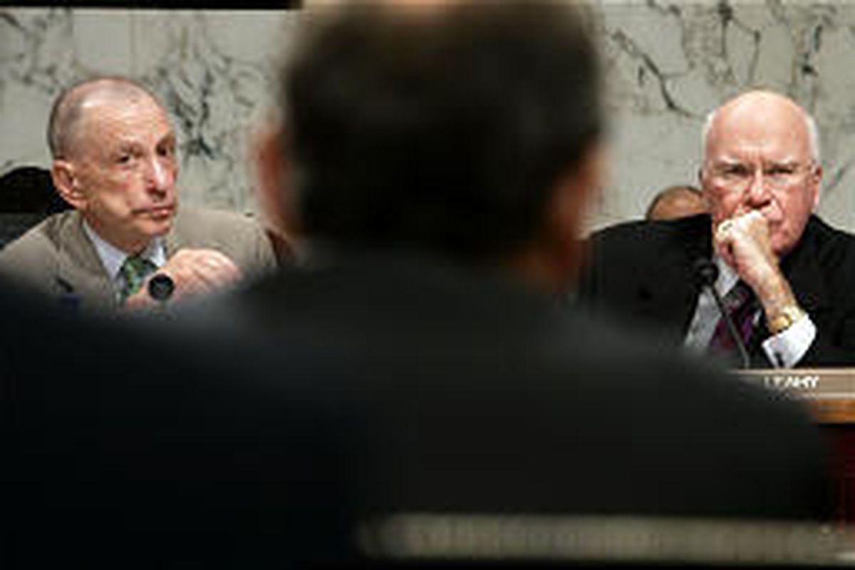 Sen. Arlen Specter, R-Pa., left, and Sen. Patrick Leahy, D-Vt., watch top court nominee John Roberts, back to camera, Thursday.