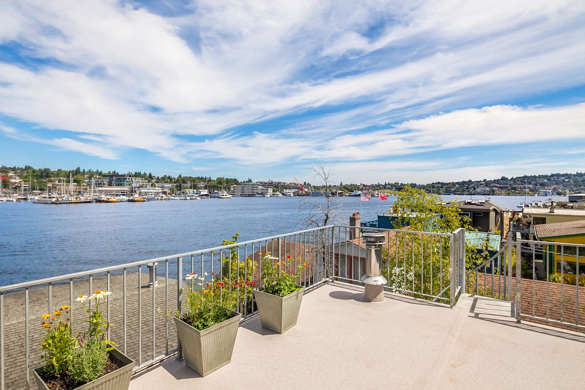This Lake Union floating home has layers of rooftop decks