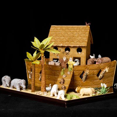 Gingerbread boat with marzipan animals in pairs on it.