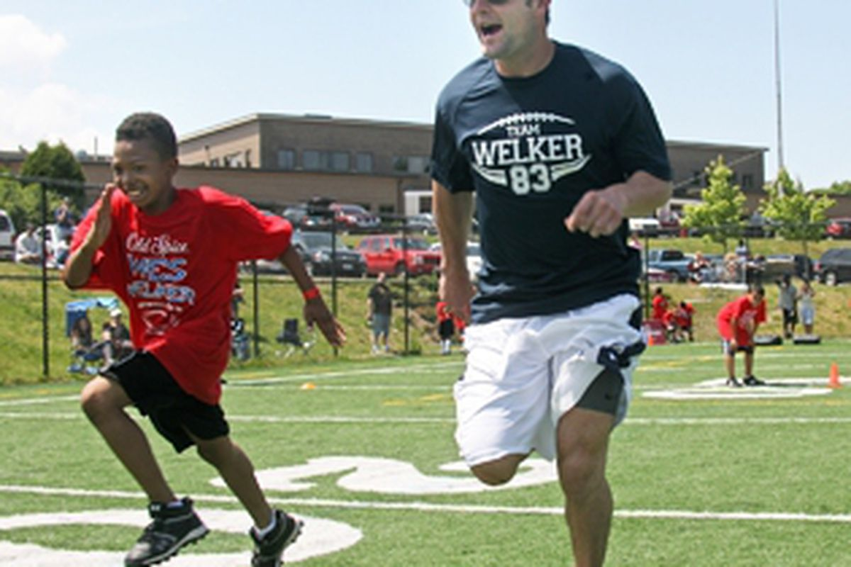 <em>Despite having his leg amputated below the knee, Wes Welker still participated in his football camp for kids</em>.