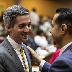 Ald. Daniel La Spata (1st) chats with Ald. Felix Cardona Jr. (31st) during their first Chicago City Council meeting at City Hall, Wednesday, May 29, 2019.