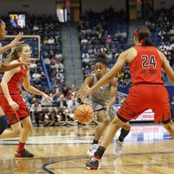 UConn�s Crystal Dangerfield (5) tries to split two Maryland defenders with a pass to Azura Stevens (23).