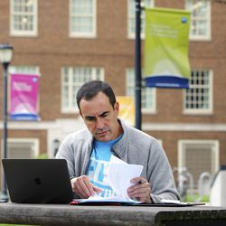 Gregg Gonsalves, an epidemiologist and global health advocate, outside the Laboratory of Epidemiology and Public Health at Yale University in New Haven, Conn. | Photo by John D. and Catherine T. MacArthur Foundation via AP