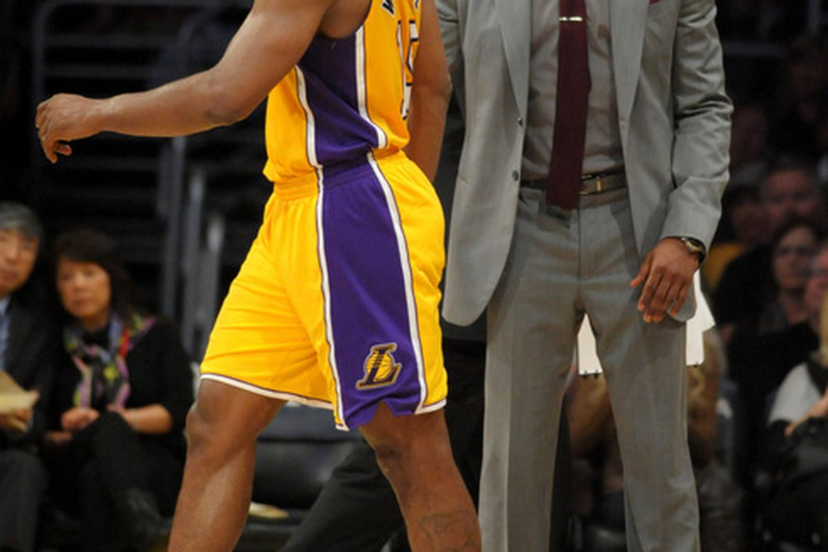 Apr 13, 2012; Los Angeles, CA, USA; Los Angeles Lakers guard Kobe Bryant (right) talks with forward Metta World Peace (15) during the game against the Denver Nuggets at the Staples Center. Mandatory Credit: Kirby Lee/Image of Sport-US PRESSWIRE