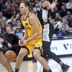 Utah Jazz forward Bojan Bogdanovic (44) drops the ball but gets it back as San Antonio Spurs guard Dejounte Murray (5) guards him during an NBA game at Vivint Arena in Salt Lake City on Friday, Feb. 21, 2020. The Jazz lost 104-113.