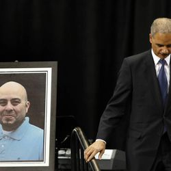Attorney General Eric Holder walks past a portrait of slain TSA officer Gerardo Hernandez after delivering remarks  during the public memorial service for Hernandez, Tuesday, Nov. 12, 2013. Hernandez was the first TSA officer killed in the line of duty when a gunman pulled a rifle from a bag and shot the 39-year-old father of two on Nov. 1, at Los Angeles International Airport. Two TSA officers and a teacher were injured before airport police wounded the gunman, Paul Ciancia.