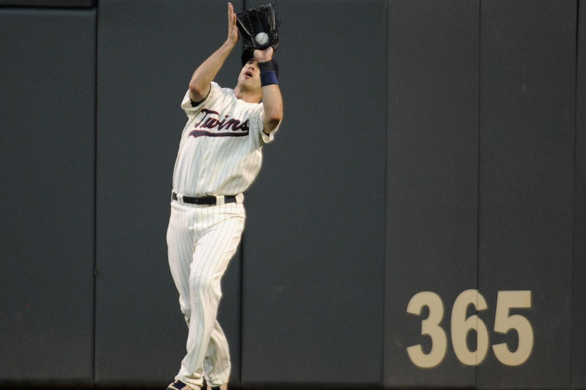 MINNEAPOLIS, MN - AUGUST 18: Joe Mauer #7 of the Minnesota Twins makes a catch in right field in the second inning against the New York Yankees on August 18, 2011 at Target Field in Minneapolis, Minnesota. (Photo by Hannah Foslien/Getty Images)