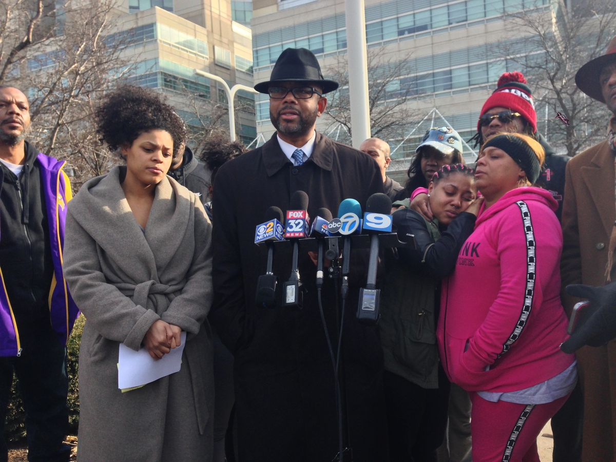 Nina Robertson, left; Robertson family lawyer Douglas Hopson, middle; and Candice Hackett, right, sister of Chad Robertson, discuss Chad Robertson's shooting outside John H. Stroger Jr. Hospital of Cook County on Friday. | Andrea Salcedo/Sun-Times