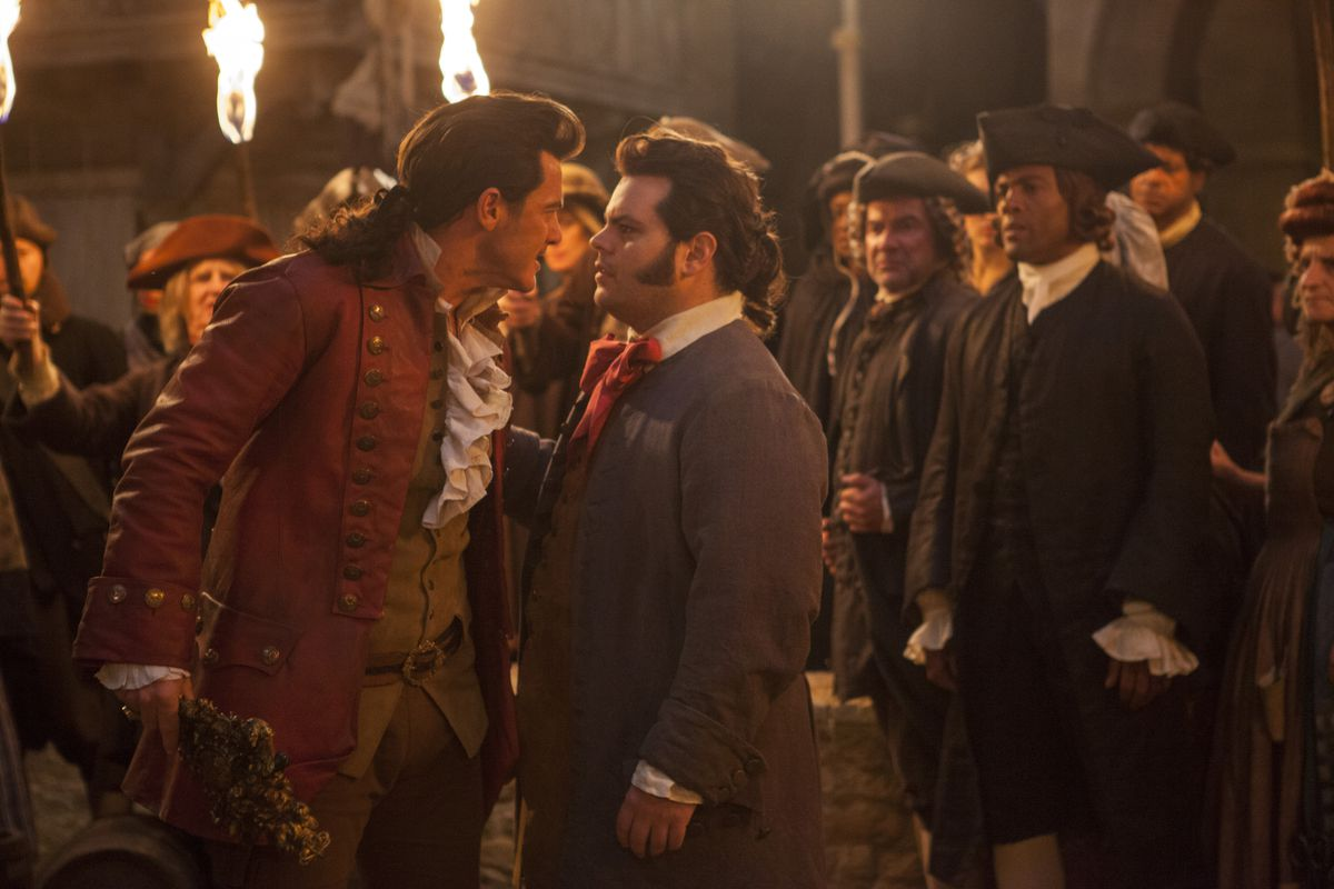 Gaston (Luke Evans) stares down LeFou (Josh Gad) in a screenshot from Beauty and the Beast