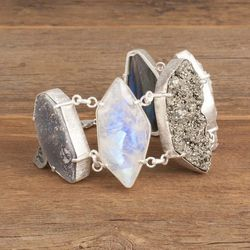 """The king of all statement bracelets: the <a href=""""http://adornbysarahlewis.com/collections/bracelets/products/throwin-stones-bracelet"""">Throwin' Stones Bracelet</a>, $448"""