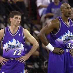 Utah Jazz's John Stockton, left, and Karl Malone watch as the Sacramento Kings walk onto the court following a timeout during the third quarter of Game 5 of a Western Conference first-round playoff series, Wednesday, April 30, 2003, in Sacramento, Calif. The Kings won 111-91, winning the series 4-1.