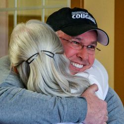 Matt Heninger, who was adopted as a baby, hugs Joyce Burgener as they meet for the first time. Heninger found his biological family after using the AncestryDNA test.