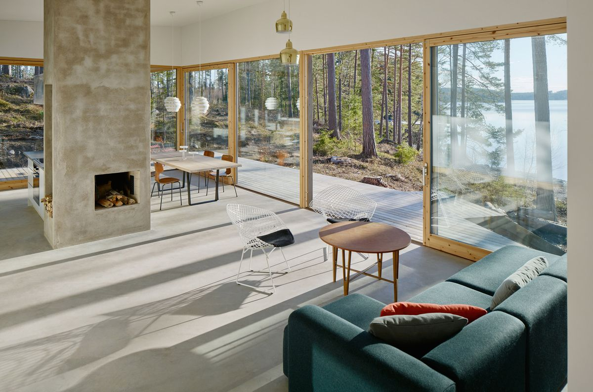 Expansive living room with concrete floor and lots of windows